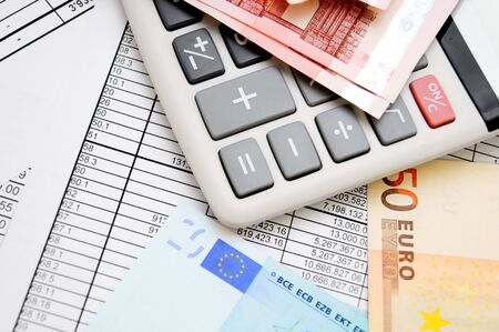 The calculator and money. On documents. Stock Photo - 17237001