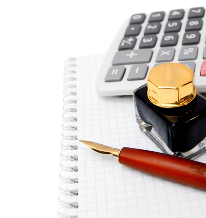Ink, the calculator and pen on a notebook. Stock Photo - 17233185