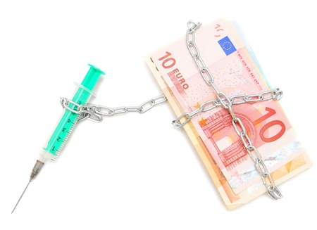 Syringe is chained by a chain to banknotes (euro). Stock Photo - 17233263