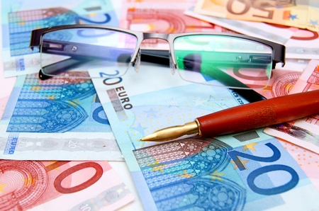 Pen and Glasses on banknotes (euro). Stock Photo - 17237077