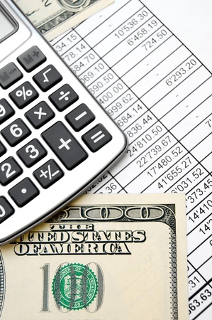Calculator and dollars on documents. Stock Photo - 17237026