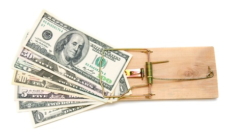 Money in a mousetrap. On a white background. Stock Photo - 17234625