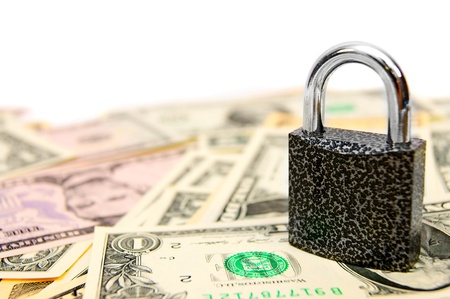 Lock on money. On a white background. Stock Photo - 17233940