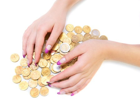 pity: Heap of gold coins and a hand. On a white background.