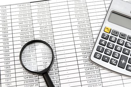 Magnifier, the calculator and documents Stock Photo - 17237006