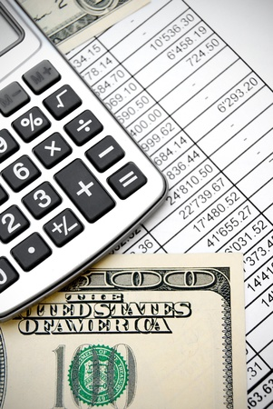 Calculator and dollars on documents Stock Photo - 17237018