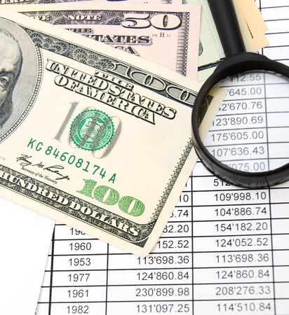 Magnifier and dollars on documents Stock Photo - 17237015