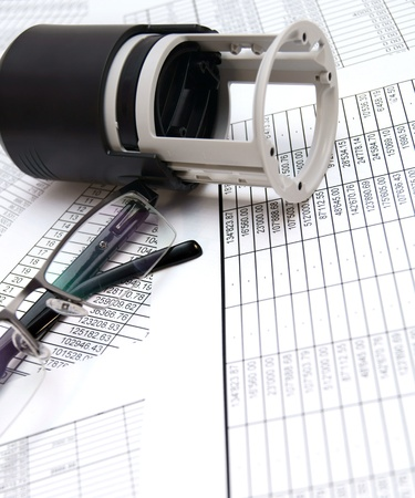 Press and Glasses on documents  Stock Photo