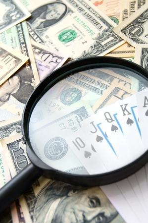 Magnifier and game cards on banknotes Stock Photo - 17237008