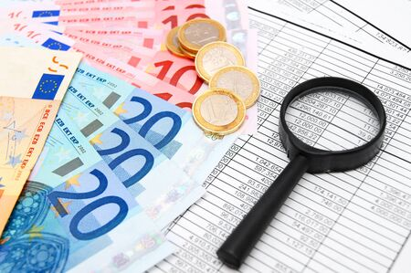 Magnifier, euro and coins on documents  Stock Photo - 17237073