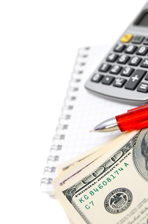 Calculator, banknotes and Pen on a notebook Stock Photo - 17233448