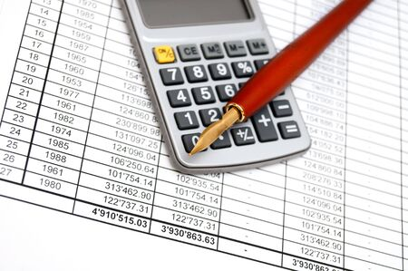 Calculator and pen on documents. Stock Photo - 17224084