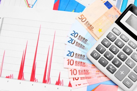 Calculator, money (euro) on graphs. Stock Photo - 17237028