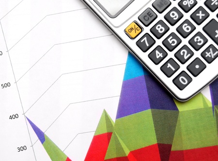 Calculator and graphs. Stock Photo - 17236999