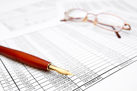 Pen and Glasses. On documents. Stock Photo