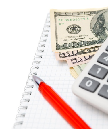 Red pen, the calculator and money on a notebook. Stock Photo - 17213535