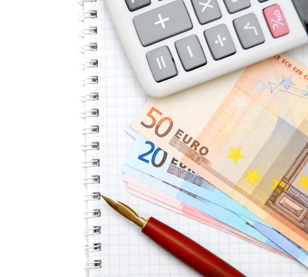 Pen, banknotes and the calculator on a notebook  Stock Photo - 17223375