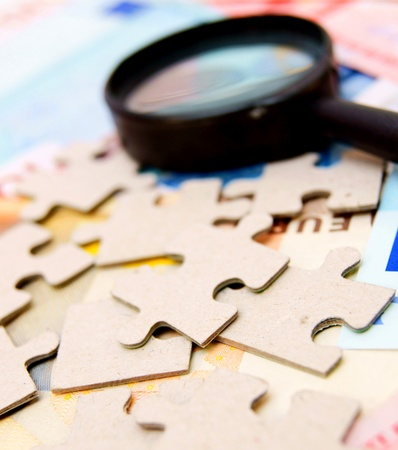 Puzzle and magnifier on documents Stock Photo - 17213540