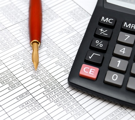 Pen and the calculator on documents  Stock Photo - 17224025