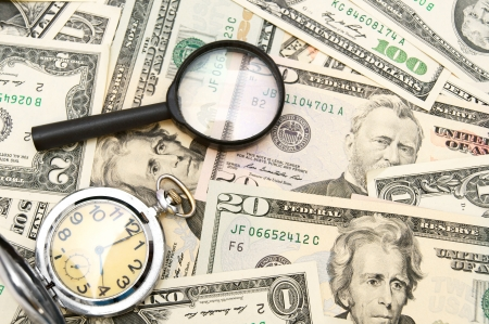 Magnifiers and watch on money
