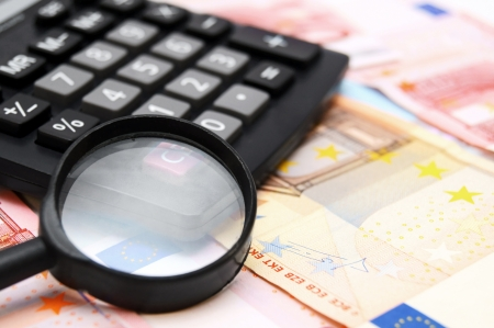 Magnifier and the calculator for euro banknotes  photo