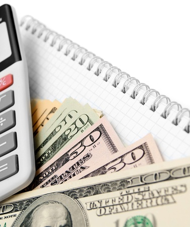 Money and the calculator for a notebook Stock Photo - 17217723