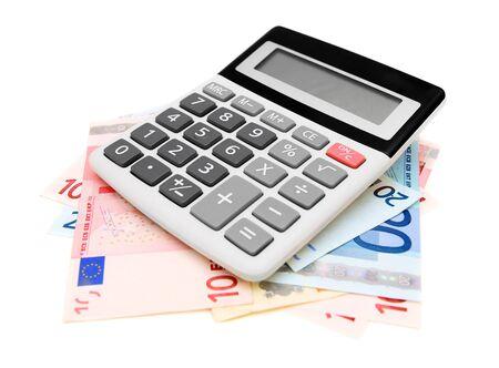 Calculator and money on white  Stock Photo