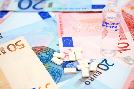 Tablets and medicines on money  Stock Photo - 17217892