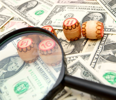 enlarger: Magnifier and lotto on banknotes  dollars   Stock Photo