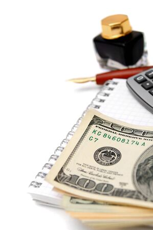 Money , pen, ink and calculator on the notebook Stock Photo - 17217501