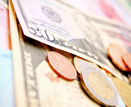 Coins on banknotes  photo