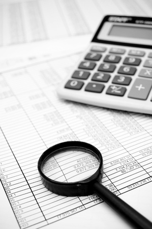 Magnifier and the calculator on documents  Stock Photo - 17217746