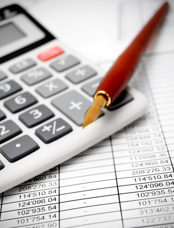Calculator and pen on documents Stock Photo - 17217656
