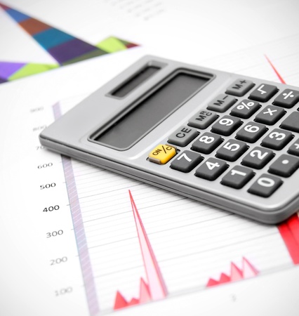 Calculator on graphs Stock Photo - 17217455