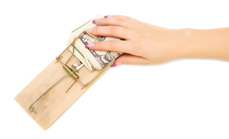 Hand with money in a mousetrap  On a white background  photo