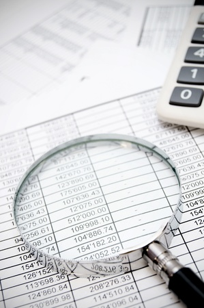 Calculator and magnifier on documents  Stock Photo