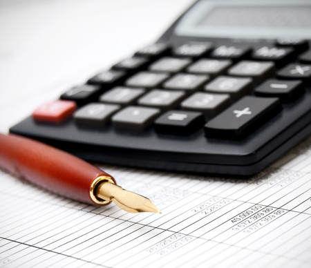 Pen and the calculator on documents  Stock Photo