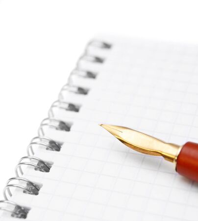 Pen and a notebook  On a white background Stock Photo - 17217419