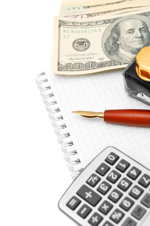 Pen, the calculator, dollars and a notebook  Stock Photo - 17217550