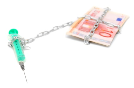 Syringe, chain and pack of euro of banknotes  Stock Photo - 17203612