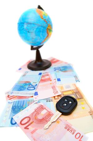Key from the car and globe for euro banknotes  photo