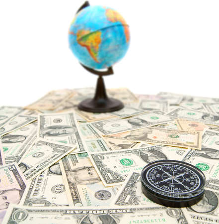 Compass and globe on dollars  On a white background  photo