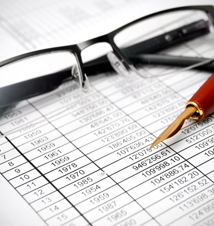Glasses and pen on documents Stock Photo - 17220545