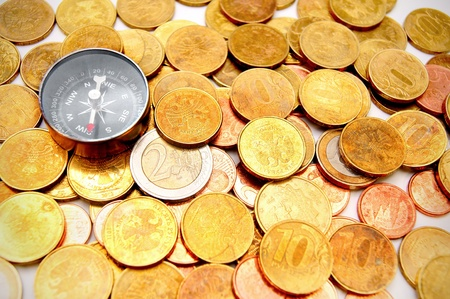 Compasses and gold coins  photo