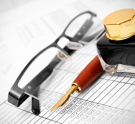 Glasses, pen and ink on documents Stock Photo - 17220487