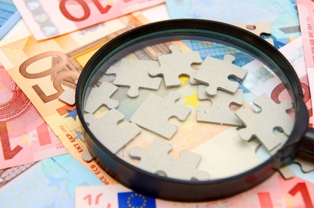 Magnifier and puzzle for euro banknotes Stock Photo - 17203869