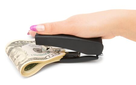 Stapler, dollars and a female hand  On a white background  photo