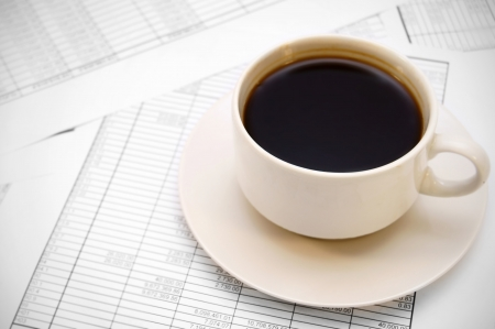 Cup from coffee on documents  photo