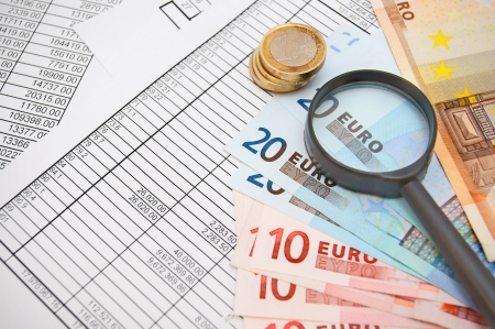 magnifiers, money on documents. Stock Photo - 22243824