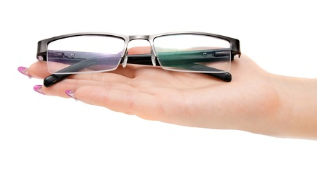objec: Glasses on a female hand. On a white background.